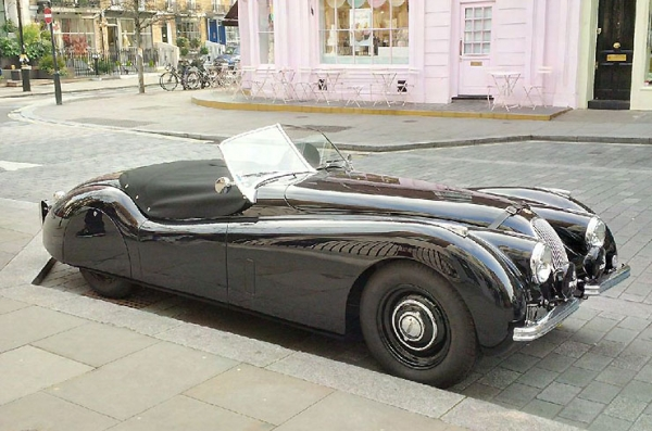 Smart and spatted XK 120 Roadster in the pink in London