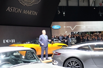 Aston's CEO Andy Palmer addresses a throng of marque enthusiasts. Should that be a 'Bond' of 007 fans?