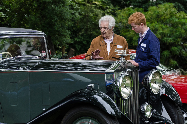 Peter was always very generous with his time. Here, he explains the intrinsic elegance of his own 1933 Rolls-Royce Phantom II Continental to a young enthusiast (Graham Glen)
